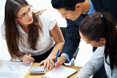 Buy stock photo Portrait of executives calculating finance in a meeting