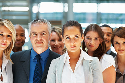 Buy stock photo Group of executives standing next to each other indoors