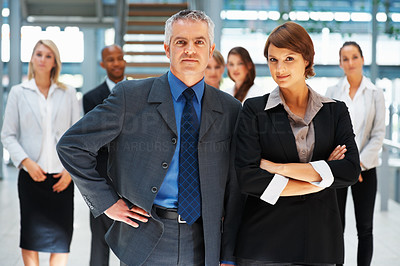 Buy stock photo View of confident team with colleagues in background