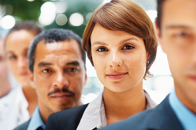 Buy stock photo Focus on executive woman with colleagues in front and back of her