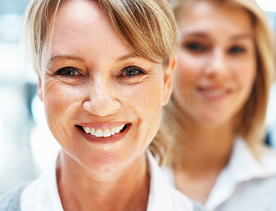 Buy stock photo Focus on businesswoman with colleagues in back of her