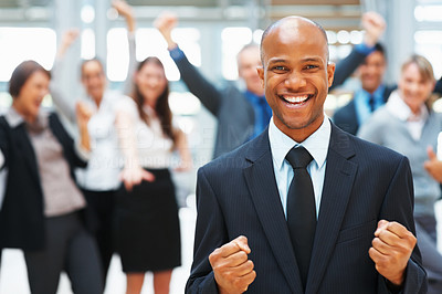 Buy stock photo View of enthusiastic businessman with excited colleagues throwing arms in air