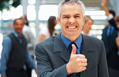 Buy stock photo Portrait of senior executive giving thumbs up