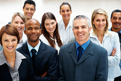 Buy stock photo View of smiling senior executive with his team
