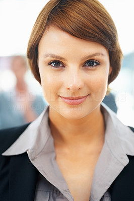 Buy stock photo Closeup portrait of confident business woman with colleagues in background