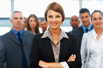 Buy stock photo Female executive with colleagues in distance