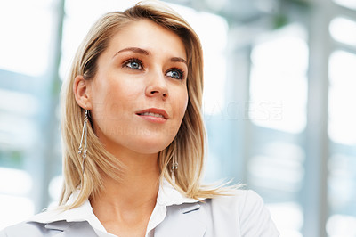 Buy stock photo Closeup of pretty female executive looking into distance
