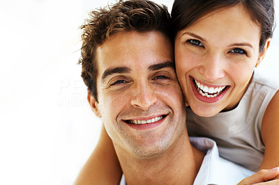 Buy stock photo Closeup of a smiling young woman hugging a man from behind against white background