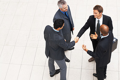 Buy stock photo Top view of group of executives shaking hands