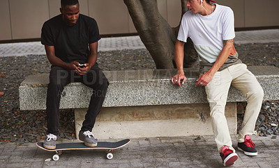 Buy stock photo Shot of two skaters sitting together