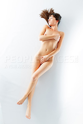 Buy stock photo Shot of a beautiful nude female isolated on white in a studio