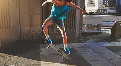 Buy stock photo Cropped shot of a young woman skating in the city