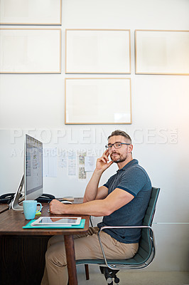Buy stock photo Portrait of a male designer working on his computer in a modern office