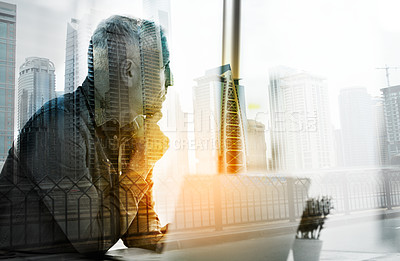 Buy stock photo Shot of a businessman using a laptop in his office superimposed over a cityscape