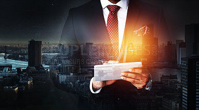 Buy stock photo Cropped shot of an unidentifiable businessman using a tablet superimposed over a cityscape