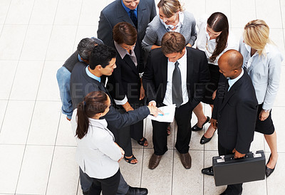 Buy stock photo Top view of executive with colleague showing him report