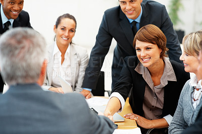 Buy stock photo Happy young female executive shaking hands with senior executive