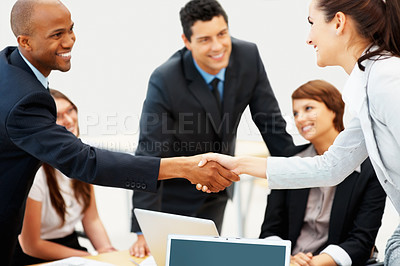 Buy stock photo Female executive shaking hands with colleague during meeting