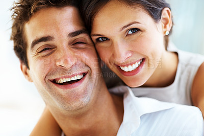 Buy stock photo Closeup portrait of a happy young couple smiling together
