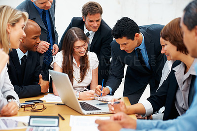 Buy stock photo Business people sitting around table indoors
