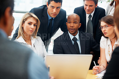 Buy stock photo Group of multi ethnic business people discussing with laptop on table
