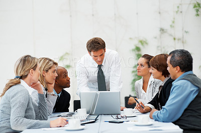 Buy stock photo Executive discussing proposal with colleagues at table indoors