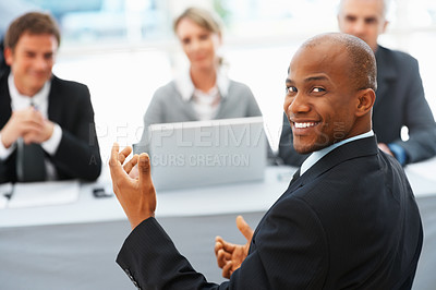 Buy stock photo Portrait of man smiling with panel of interviewers in background