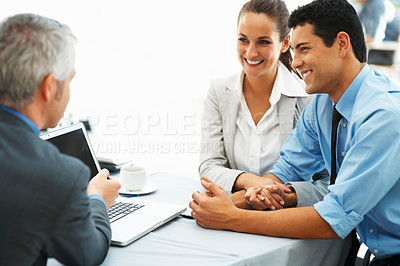 Buy stock photo Focus on business couple with mature executive discussing work on laptop