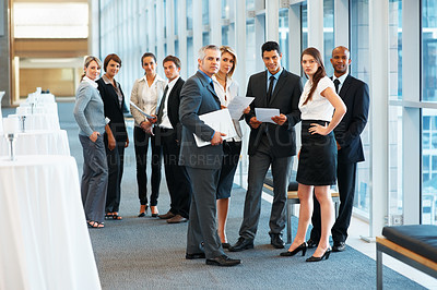 Buy stock photo Full length of business group looking at you