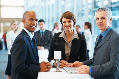 Buy stock photo Portrait of smiling business colleagues at a conference hall