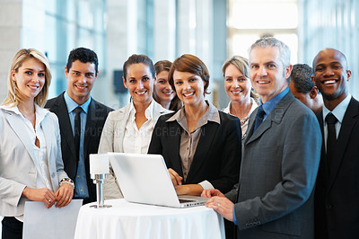 Buy stock photo Portrait of happy business team standing with laptop