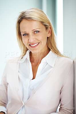 Buy stock photo Portrait of a pretty young casual busnesswoman looking happy - Indoor
