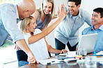 Excited businesspeople giving each other high five for successful business