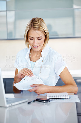 Buy stock photo Portrait of a happy young businesswoman holding envelope in hand in office