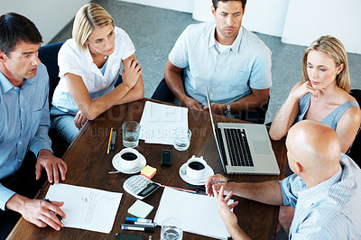 Buy stock photo Top view of business team sitting around table in a meeting at office - Teamwork
