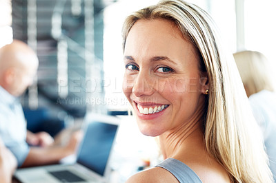 Buy stock photo Portrait of smiling young casual businesswoman in a meeting with colleagues at office