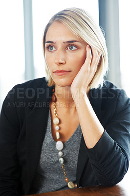Buy stock photo Portrait of a thoughtful young woman looking away with her face resting on hand