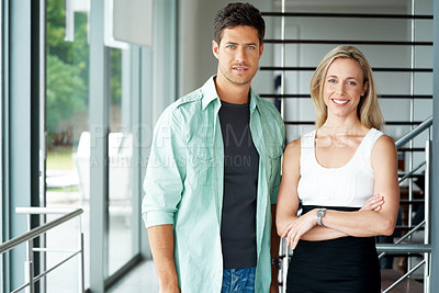 Buy stock photo Portrait of a happy young couple standing together - Indoor
