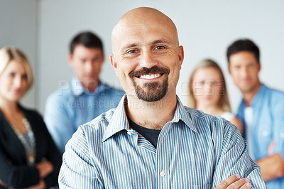 Buy stock photo Portrait of a smart businessman along with business colleague standing behind