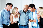 Successful business people standing together in office
