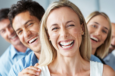 Buy stock photo Portrait of a smiling successful female leader and her business team at office