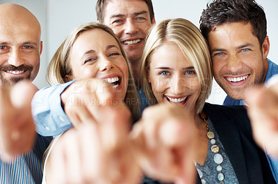 Buy stock photo Portrait of a cheerful business people pointing towards you and smiling