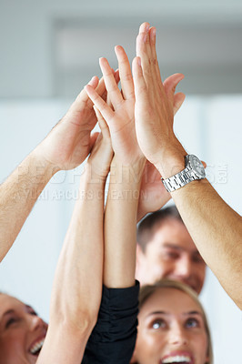 Buy stock photo Closeup portrait of hands of business people giving high five