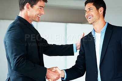Buy stock photo Portrait of successful business people shaking hands on a deal in office