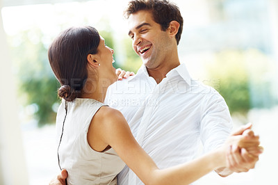 Buy stock photo Portraot of romantic young couple dancing and laughing - Outdoors