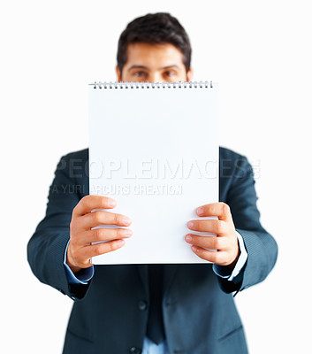 Buy stock photo Focus on notepad with executive standing in distance