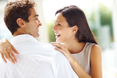 Buy stock photo Happy man and woman standing outdoors together and looking at each other