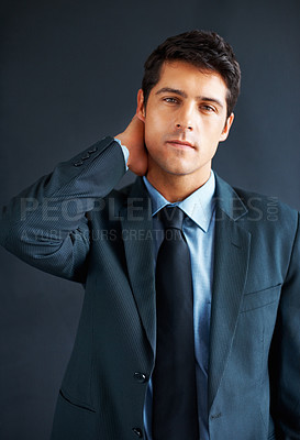 Buy stock photo Executive standing with hand on back of neck