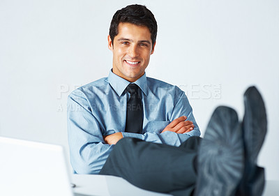 Buy stock photo Portrait of successful businessman resting his feet on desk