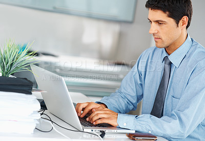 Buy stock photo Male executive typing on a laptop at work
